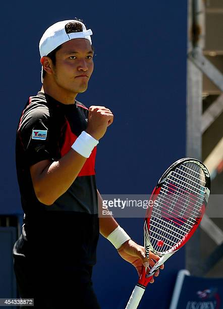 Tatsuma Ito of Japan reacts against Feliciano Lopez of Spain during their men's singles second round match on Day Five of the 2014 US Open at the...