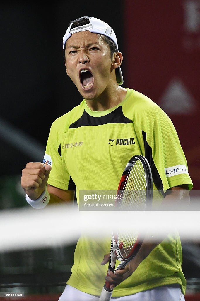 <a gi-track='captionPersonalityLinkClicked' href=/galleries/search?phrase=Tatsuma+Ito&family=editorial&specificpeople=5545179 ng-click='$event.stopPropagation()'>Tatsuma Ito</a> of Japan reacts during the men's singles second round match against Benjamin Becker of Germany on day three of Rakuten Open 2014 at Ariake Colosseum on October 1, 2014 in Tokyo, Japan.