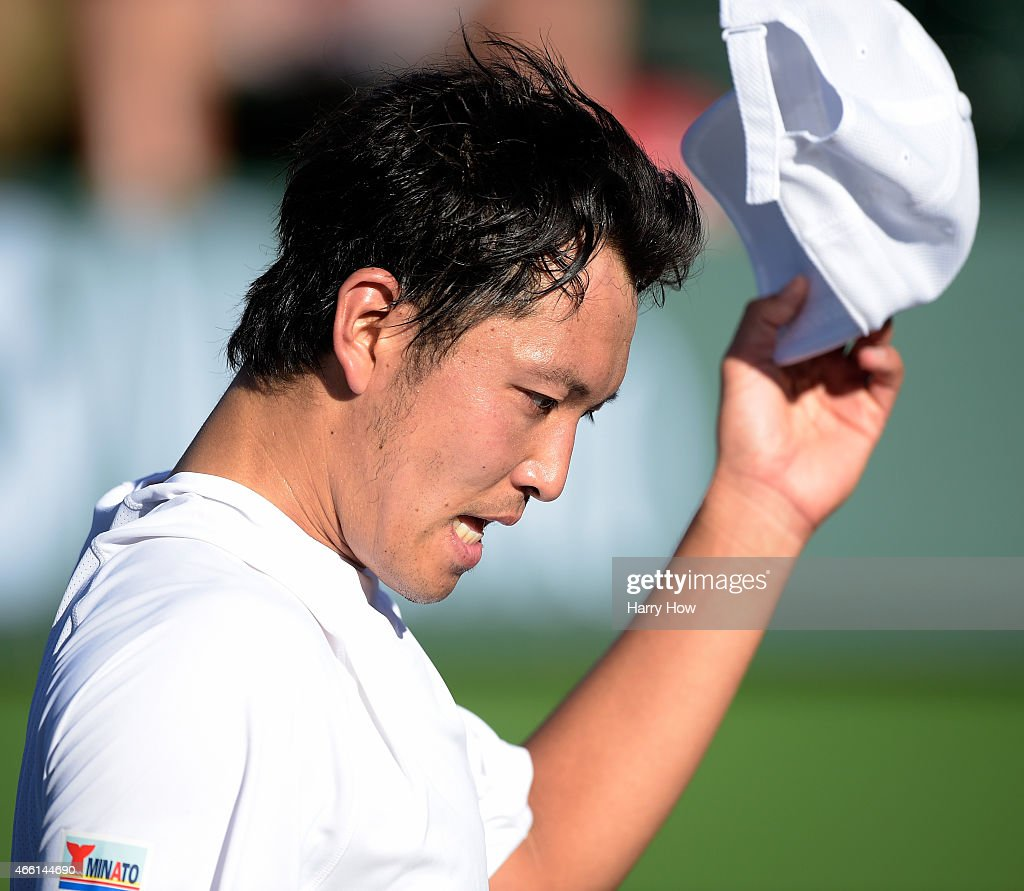 <a gi-track='captionPersonalityLinkClicked' href=/galleries/search?phrase=Tatsuma+Ito&family=editorial&specificpeople=5545179 ng-click='$event.stopPropagation()'>Tatsuma Ito</a> of Japan reacts to his loss in his match against Malek Jaziri of Tunisia during the BNP Parisbas Open at the Indian Wells Tennis Garden on March 13, 2015 in Indian Wells, California.