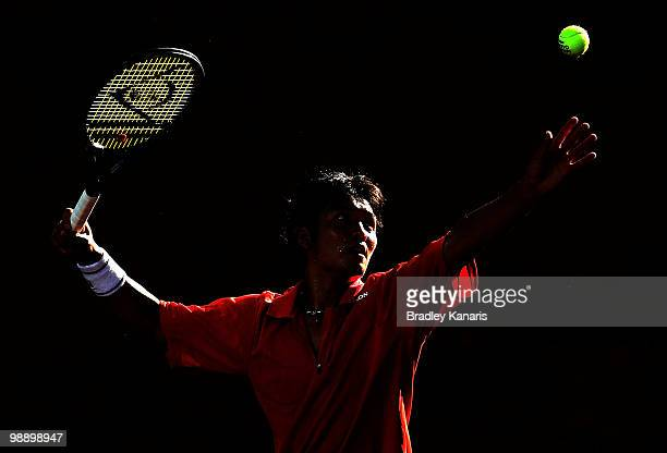 Tatsuma Ito of Japan serves during his match against Lleyton Hewitt of Australia during the match between Australia and Japan on day one of the Davis...