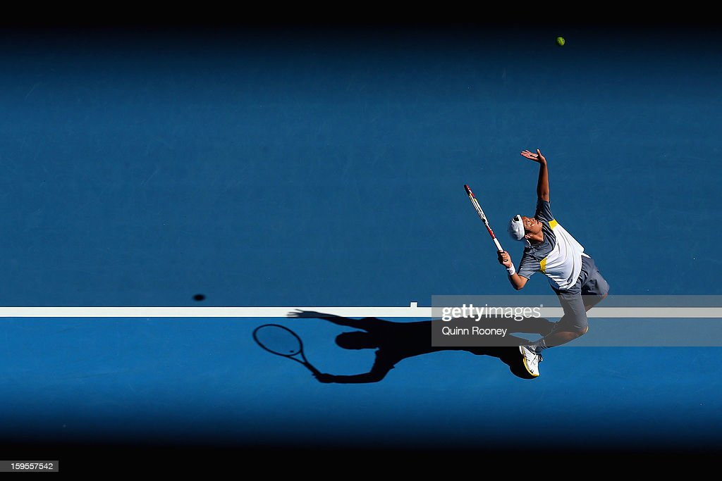 Tatsuma Ito of Japan serves in his second round match against Marcos Baghdatis of Cyprus during day three of the 2013 Australian Open at Melbourne Park on January 16, 2013 in Melbourne, Australia.
