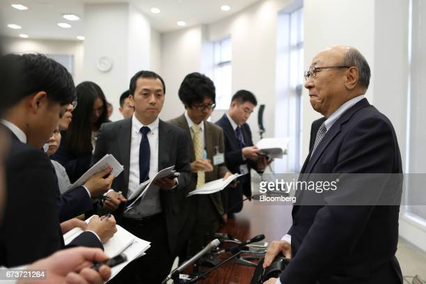 Tatsumi Kimishima president of Nintendo Co right pauses as he speaks to reporters after a news conference at the Osaka Stock Exchange in Osaka Japan...