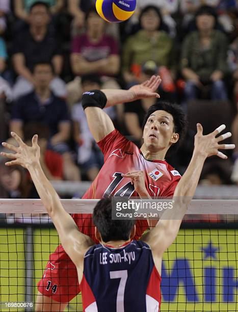 Tatsuya Fukuzawa of Japan spikes the ball against Lee SunKyu of South Korea during the FIVB World League Pool C match between South Korea and Japan...