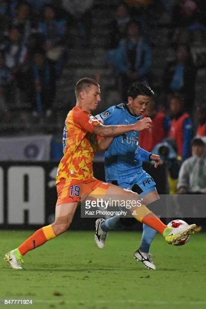 Tatsuya Hasegawa of Kawasaki Frontale and Mitchell Duke of Shimizu SPulse compete for the ball during the JLeague J1 match between Shimizu SPulse and...