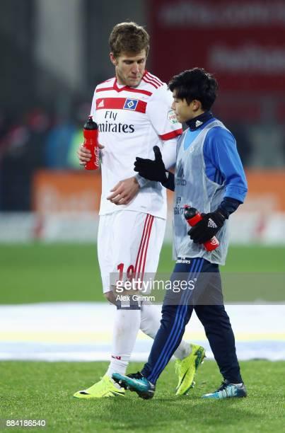 Tatsuya Ito and Sven Schipplock of Hamburg chat after the Bundesliga match between SportClub Freiburg and Hamburger SV at SchwarzwaldStadion on...