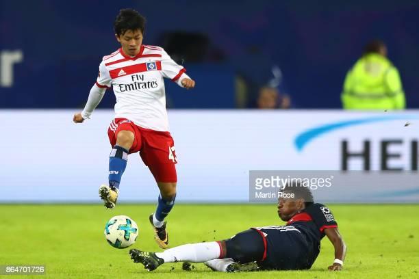 Tatsuya Ito of Hamburg fights for the ball with David Alaba of Bayern Muenchen during the Bundesliga match between Hamburger SV and FC Bayern...