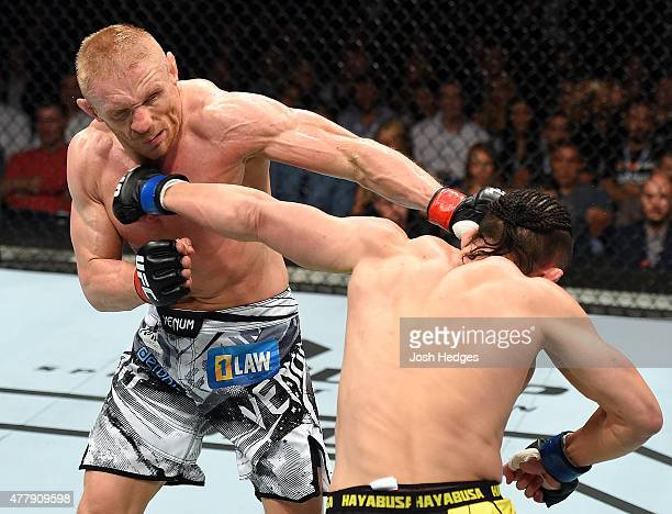 Tatsuya Kawajiri of Japan lands a punch to the face of Dennis Siver of Germany in their featherweight bout during the UFC Fight Night event at the O2...