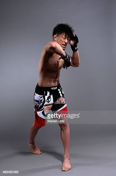 Tatsuya Kawajiri of Japan poses for a portrait during a UFC photo session on April 8 2014 in Abu Dhabi United Arab Emirates