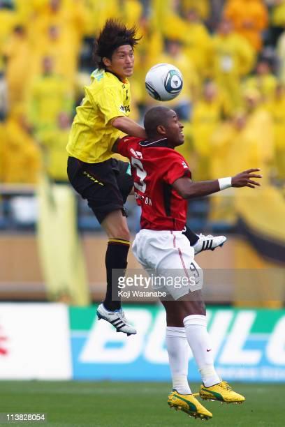 Tatsuya Masushima of Kashiwa Reysol and Edmilson of Urawa Red Diamonds compete for the ball during JLeague match between Kashiwa Reysol and Urawa Red...