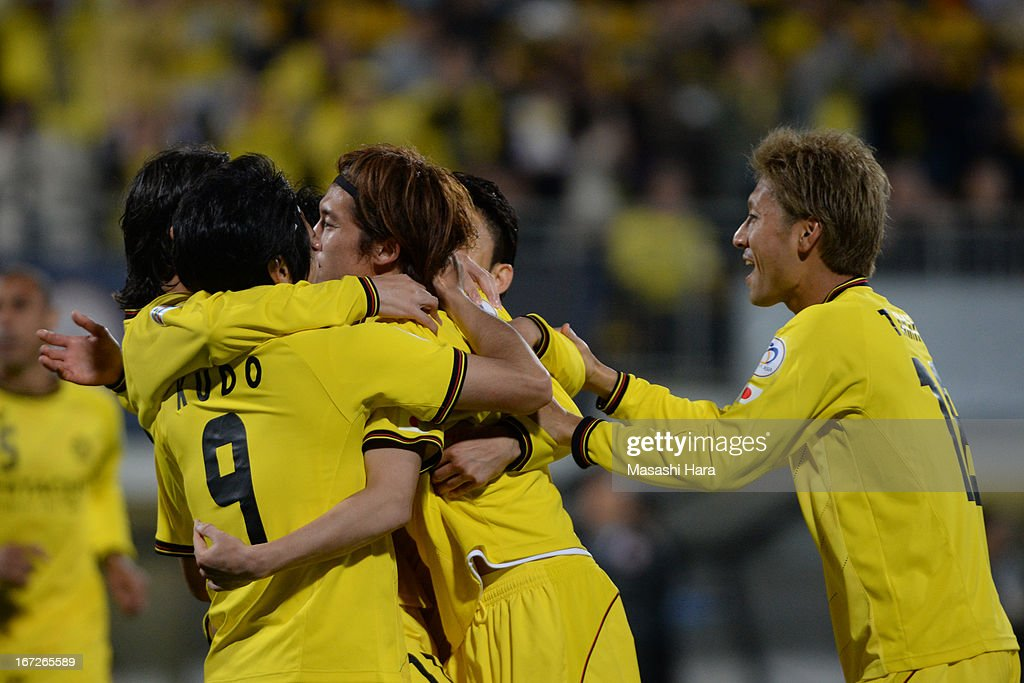 Tatsuya Masushima #5 of Kashiwa Reysol (2R) celebrates the first goal during the AFC Champions League Group H match between Kashiwa Reysol and Guizhou Renhe at Hitachi Kashiwa Soccer Stadium on April 23, 2013 in Kashiwa, Japan.