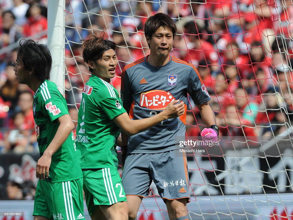 Tatsuya Morita #21,GK of Albirex Nigata reacts after saving a penalty kick by Shinzo Koroki of Urawa Red Diamonds during the J.League match between Urawa Red Diamonds and Albirex Nigata at the Saitama stadium on May 14, 2016 in Saitama, Japan.