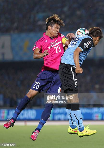 Tatsuya Yamashita of Cerezo Osaka and Junichi Inamoto of Kawasaki Frontale compete for the ball during the JLeague match between Kawasaki Frontale...
