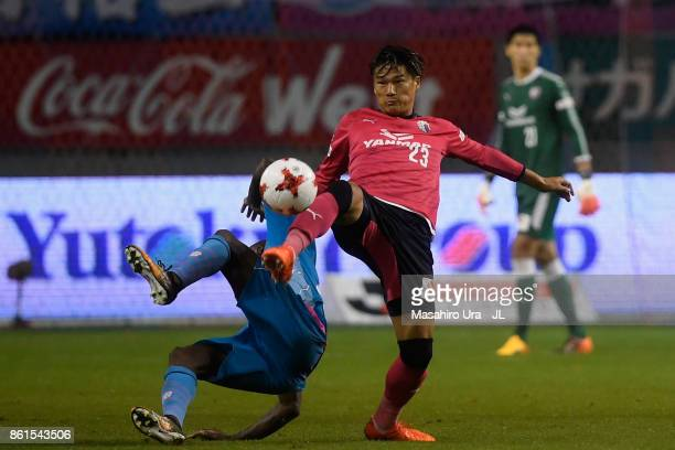 Tatsuya Yamashita of Cerezo Osaka and Victor Ibarbo of Sagan Tosu compete for the ball during the JLeague J1 match between Sagan Tosu and Cerezo...
