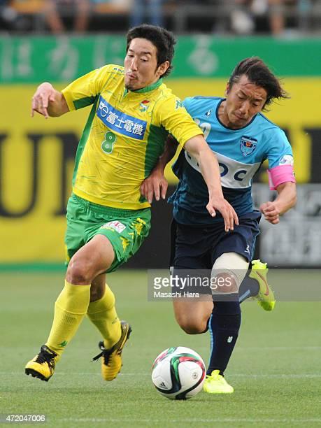Tatsuya Yazawa of JEF United Chiba and Shinichi Terada of Yokohama FC compete for the ball during the JLeague second division match between JEF...
