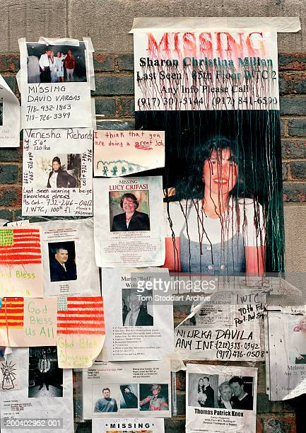 Tattered and rain damaged posters of missing persons along the sidewalks of New York as bereaved families search for their loved ones after the...