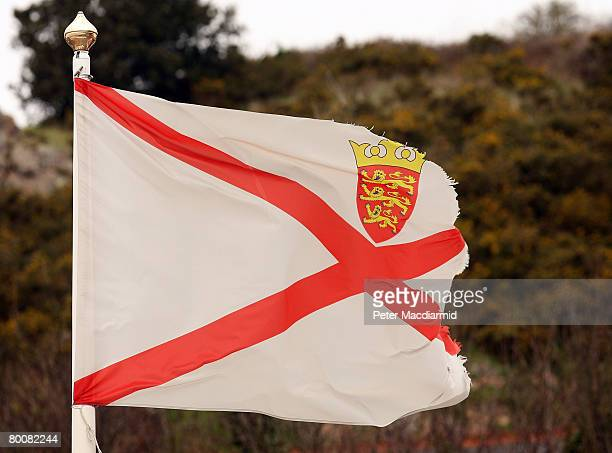 A tattered Jersey flag flies over Gorey Harbour on March 2 2008 in Jersey Channel Islands Britain's most southerly island Jersey is located 100 miles...
