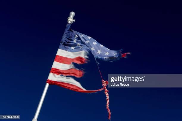 Tattered US flag on a pole