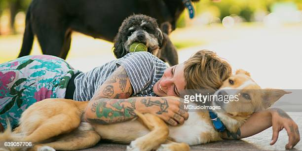 Tattoed woman relaxing with dogs