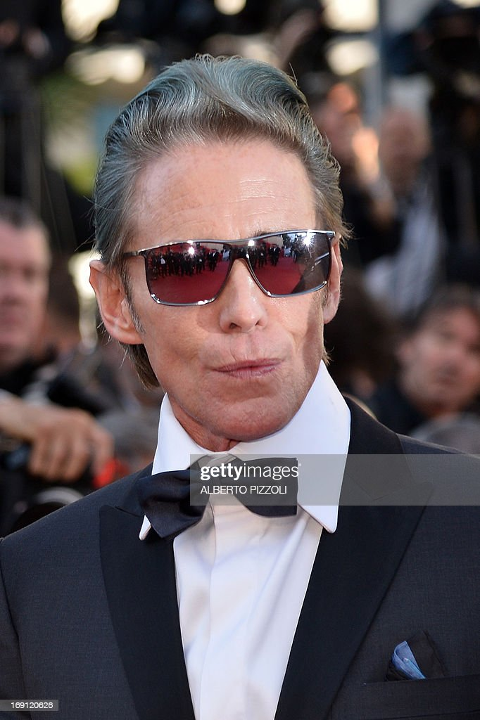 US tattoo artist and actor Mark Mahoney poses on May 20, 2013 as he arrives for the screening of the film 'Blood Ties' presented Out of Competition at the 66th edition of the Cannes Film Festival in Cannes. Cannes, one of the world's top film festivals, opened on May 15 and will climax on May 26 with awards selected by a jury headed this year by Hollywood legend Steven Spielberg. AFP PHOTO / ALBERTO PIZZOLI