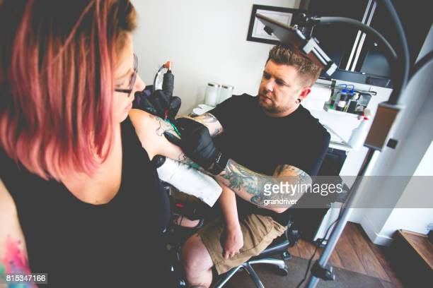 Tattoo Artist and Female Customer