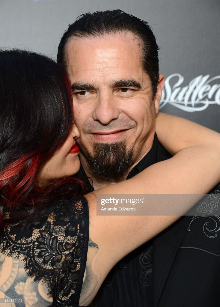 Tattoo artist and television personality Corey Miller (R) and his wife Kat Miller arrive at the premiere of 'Tattoo Nation' at ArcLight Cinemas on March 28, 2013 in Hollywood, California.
