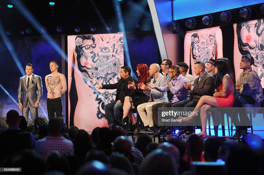 Tattoo artist Cleen Rock One presents his tattoo to judges St. Marq, James Vaughn, Megan Jean Morris, Corey Davis, Jesse Smith, Alex Rockoff, Chris Gherman, Sarah Miller, Jime Litwalk, Ashley Velazquez, and Picasso Dular on stage during the 'Ink Master' season 7 LIVE finale on May 24, 2016 in New York City.