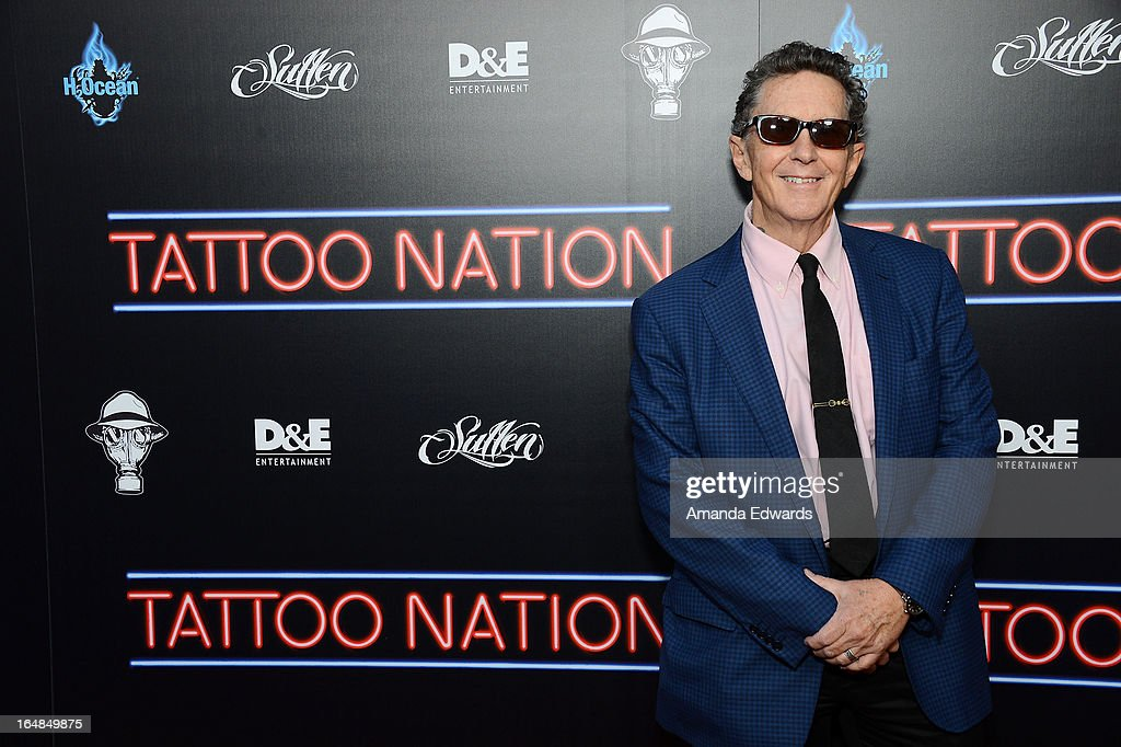 Tattoo artist Ed Hardy arrives at the premiere of 'Tattoo Nation' at ArcLight Cinemas on March 28, 2013 in Hollywood, California.