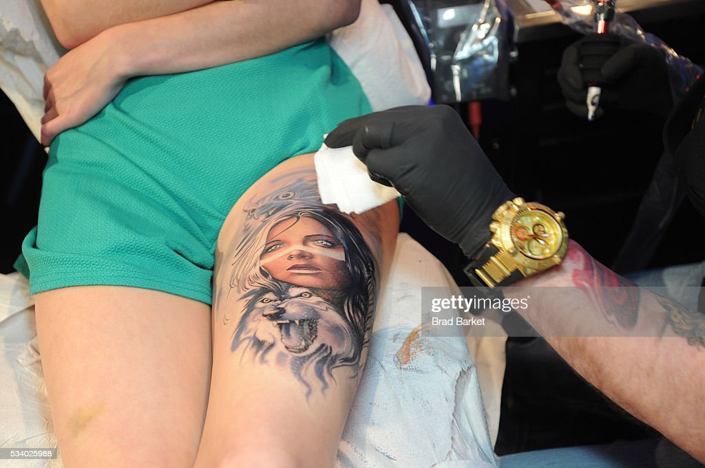 Tattoo artist Sausage tattoos on stage at the 'Ink Master' season 7 LIVE finale on May 24, 2016 in New York City.