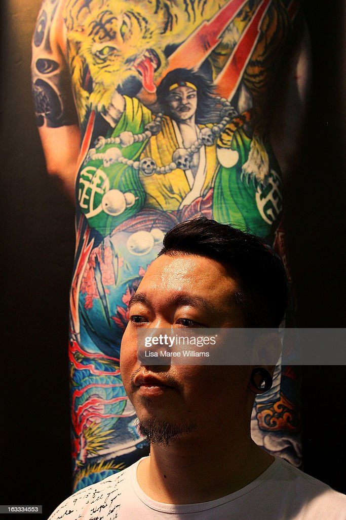 Tattoo artist Sheng poses during The Australian Tattoo & Body Art Expo at the Royal Hall of Industries, Moore Park on March 8, 2013 in Sydney, Australia. The annual three day event showcases some of Australia's best tattoo and body artists and is open to enthusiasts March 8-10.
