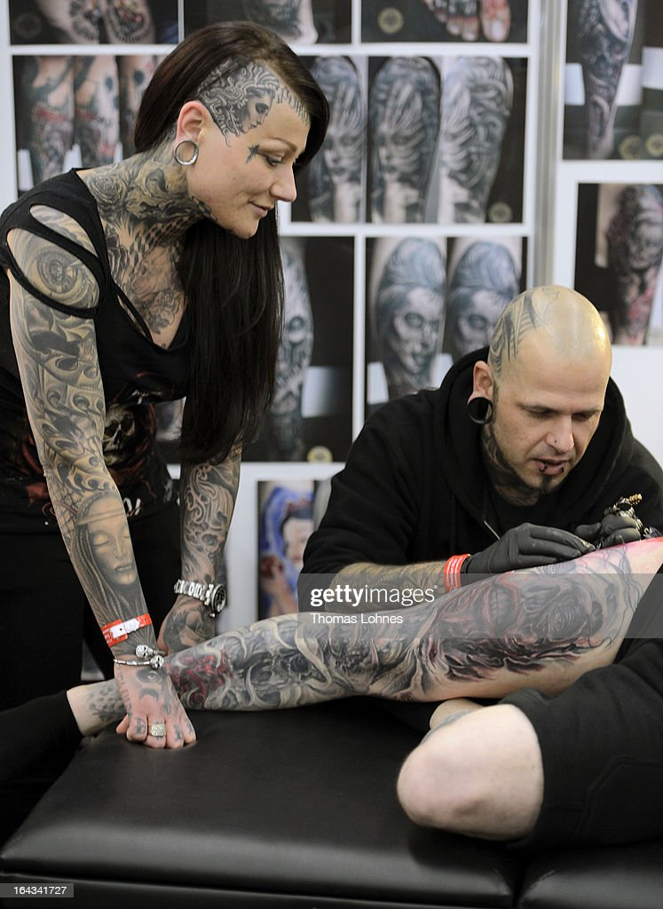 A Tattoo Artist tattooes a man during the International Tattoo Convention on March 22, 2013 in Frankfurt am Main, Germany. The Frankfurt tattoo convention is considered the world's biggest fair for the art of tattooing. More than 700 artists from all over the world will make more than 3,000 tattoos at the three-day show. The Hessian state laboratory has found carcinogens in some tattoo inks produced in China, causing warnings to be issued Europe-wide.