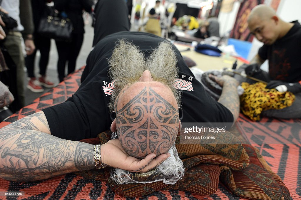 A Tattoo Artist tattooes a woman during the International Tattoo Convention on March 22, 2013 in Frankfurt am Main, Germany. TThe Frankfurt tattoo convention is considered the world's biggest fair for the art of tattooing. More than 700 artists from all over the world will make more than 3,000 tattoos at the three-day show. The Hessian state laboratory has found carcinogens in some tattoo inks produced in China, causing warnings to be issued Europe-wide.