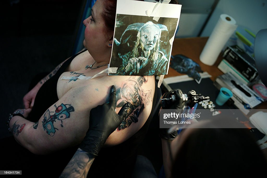A Tattoo Artist tattooes a woman during the International Tattoo Convention on March 22, 2013 in Frankfurt am Main, Germany. The Frankfurt tattoo convention is considered the world's biggest fair for the art of tattooing. More than 700 artists from all over the world will make more than 3,000 tattoos at the three-day show. The Hessian state laboratory has found carcinogens in some tattoo inks produced in China, causing warnings to be issued Europe-wide.
