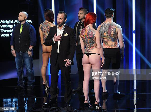 Tattoo artist Walter Frank Matthew Hixon and Walter Frankreact during a taping of Spike TV's 'Ink Master' Season 4 LIVE Finale at SIR Stage 37 on May...