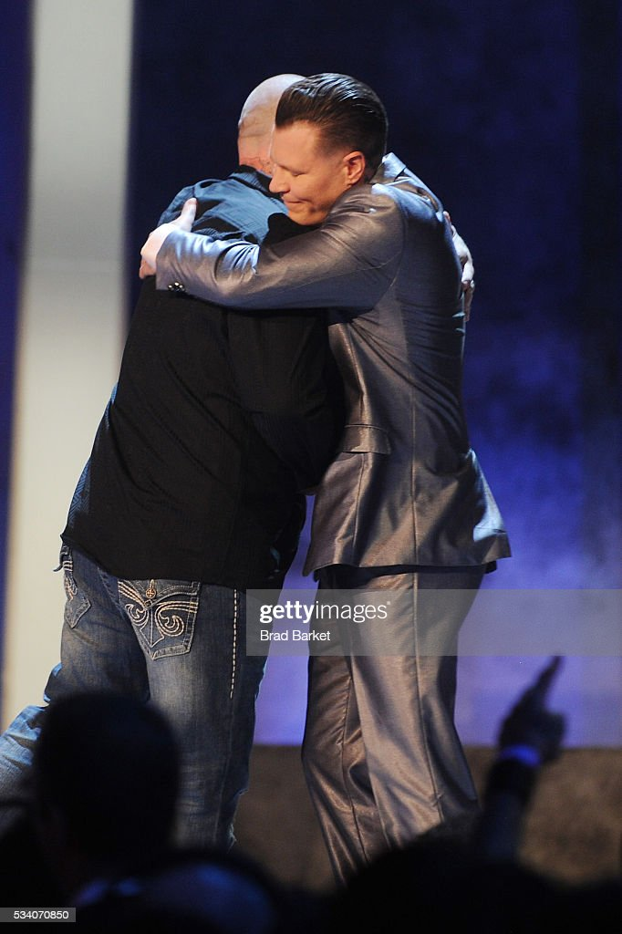 Tattoo artists Christian Buckingham (L) and Anthony Michaels apper on stage during the 'Ink Master' season 7 LIVE finale on May 24, 2016 in New York City.