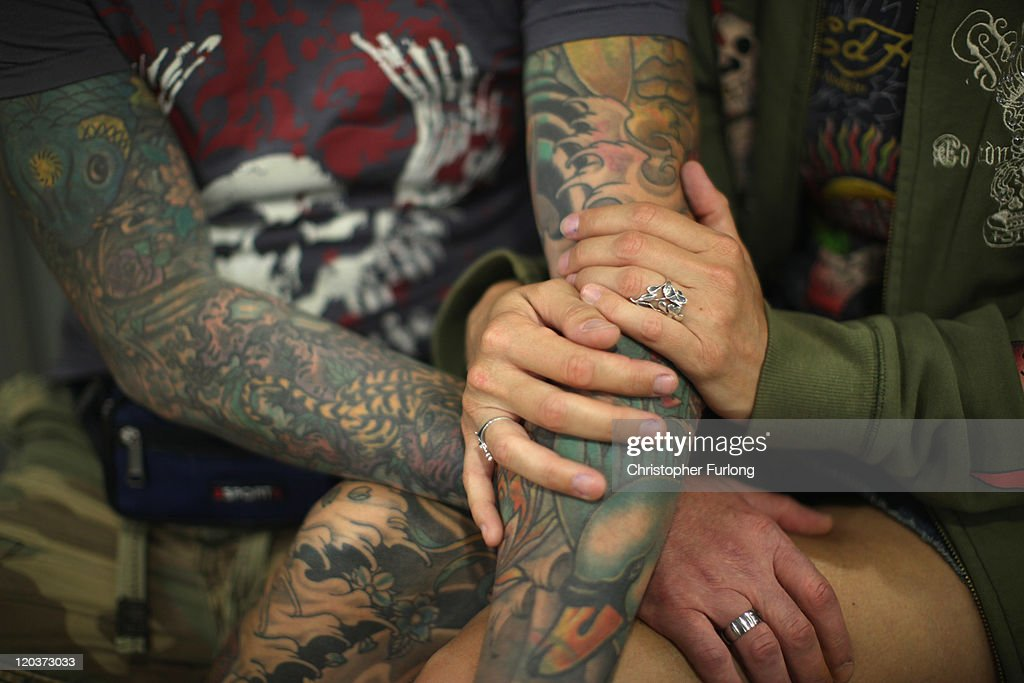 Tattoo enthusiasts relax during The Tattoo Jam Festival on August 5, 2011 in Doncaster, England. The Tattoo Jam Festival is Britain's biggest gathering of tattoo professionals and skin art devotees. The event hosts over 300 artists working in the exhibition hall of Doncaster Racecourse revealing their latest designs and techniques.