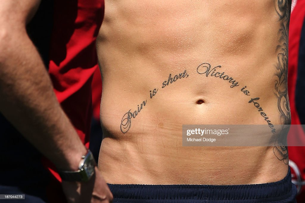 A tattoo is seen on the stomach of Jeremy Howe during a Melbourne Demons AFL training session at Gosch's Paddock on November 6, 2013 in Melbourne, Australia.