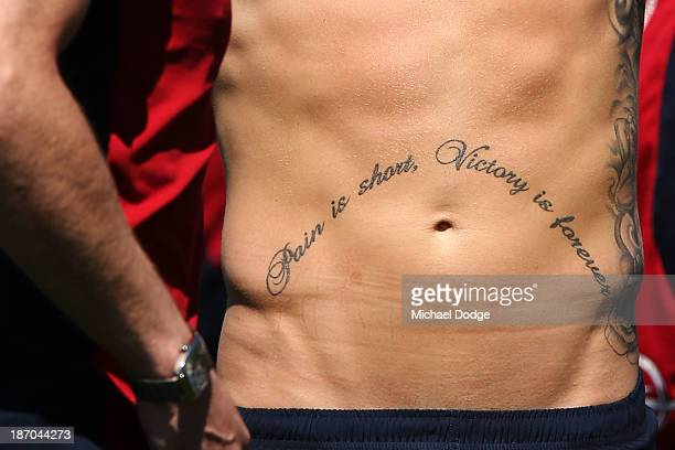 A tattoo is seen on the stomach of Jeremy Howe during a Melbourne Demons AFL training session at Gosch's Paddock on November 6 2013 in Melbourne...