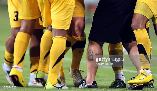 A tattoo of Cuban leader Fidel Castro is seen on the leg of Argentine football legend and coach of UAE's AlWasl club Diego Maradona during his team's...