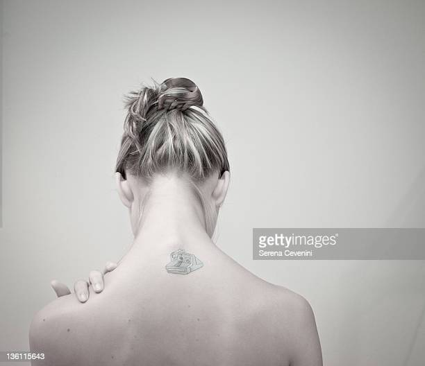 Tattoo on back of woman