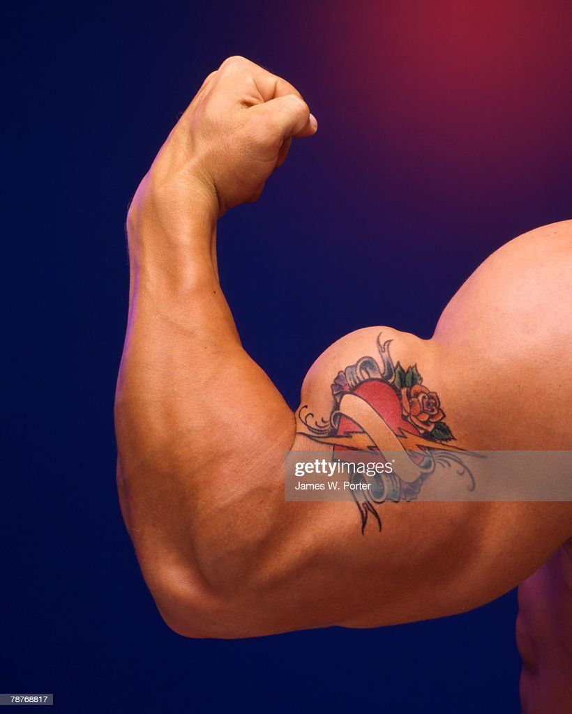 Tattoo on Man's Bicep : Stock Photo