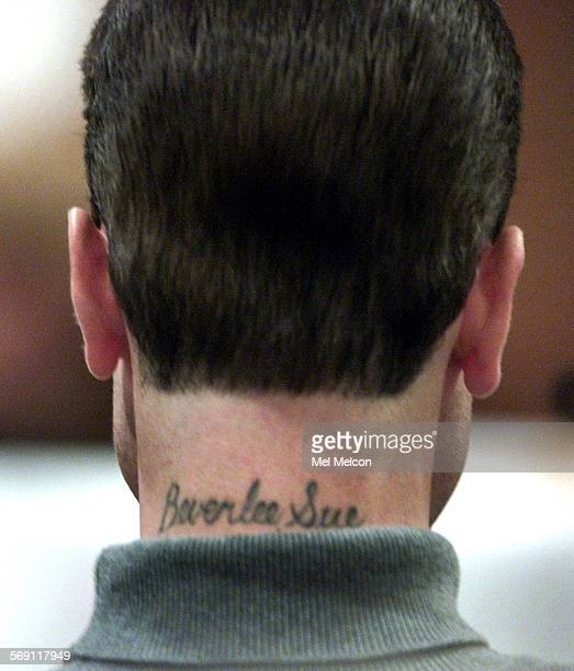 Tattoo on the neck of defendant Justin Merriman bears the name of his mother who testified for the defense Wednesday afternoon during his murder...