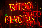 Neon sign in the window of a tattoo parlor in New York City