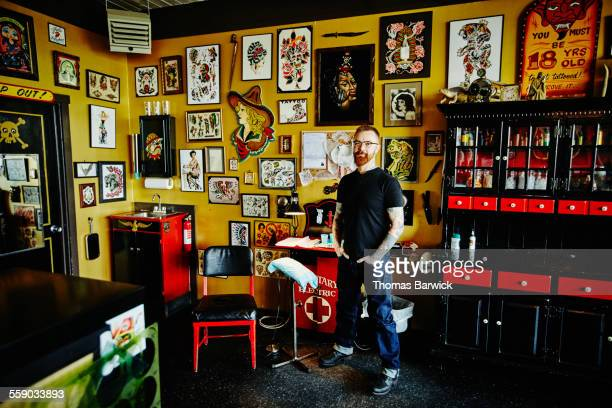 Tattoo shop owner standing in tattoo shop