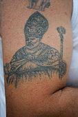 A tattoo with San Paolno is displayed during the annual Festa dei Gigli on June 26 2016 in Nola Italy When St Paolini the bishop of Nola returned in...