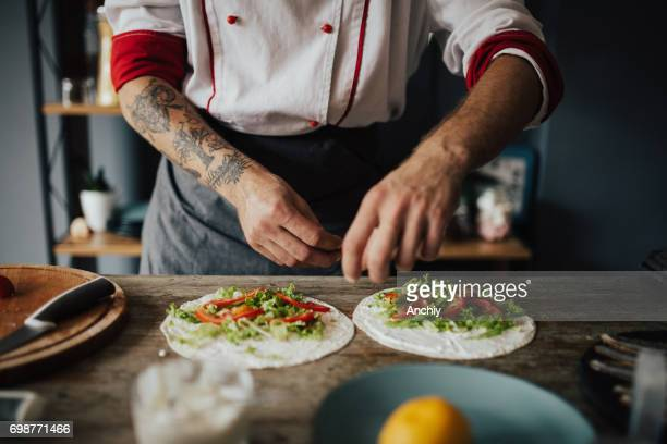 Tattood chef is making wraps at home