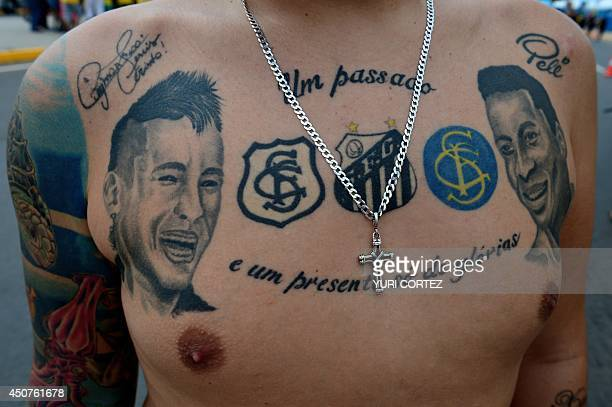 A tattooed Brazilian supporter stands outside The Castelao Stadium in Fortaleza on June 17 ahead of the Group A football match between Brazil and...