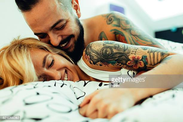 Tattooed Couple Flirting In Bed.