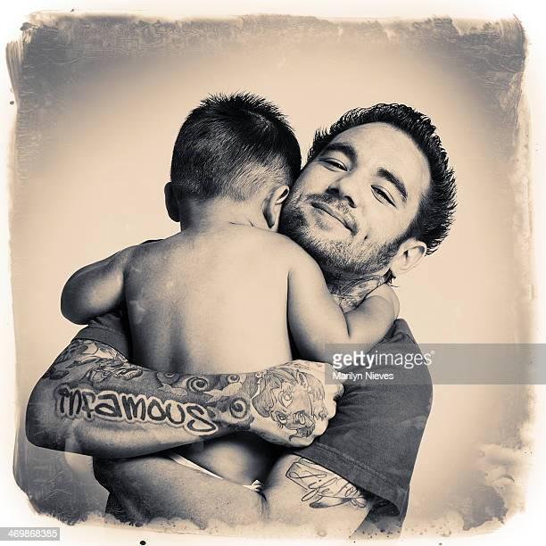 tattooed daddy hug
