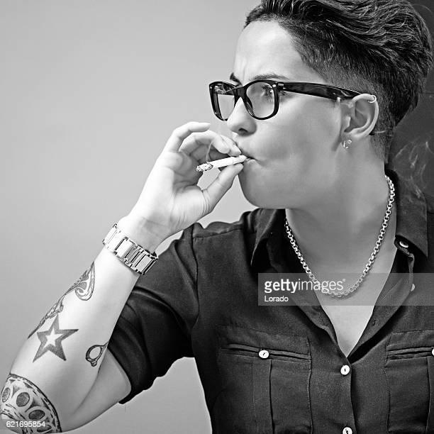 Tattooed female barber smoking