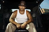 Tattooed Hispanic man in limousine